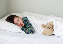 Boy Sleeping With Old Teddy Bear