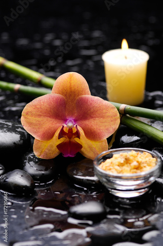 Poster Spa spa concept –orange orchid with stones, candle and bamboo grove