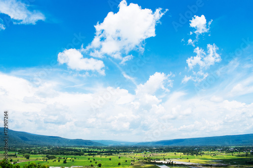 Spoed Foto op Canvas Natuur View of rice field with mountain and sky in Thailand.