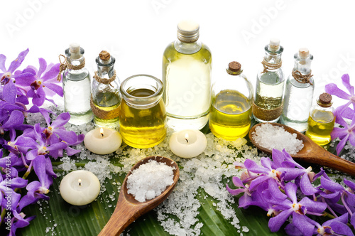 Foto op Canvas Spa Spa setting on banana leaf with purple orchid ,candle, salt in spoon ,bottle oil