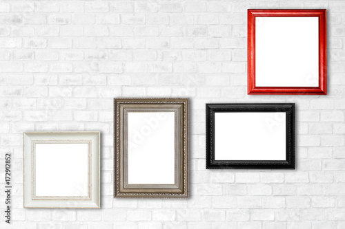 wood frames on white brick wall - Buy this stock photo and explore ...