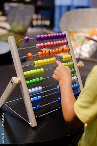 Close up on colorful abacus playful activity, educational interior background. Happy joyful developmental lifestyle - 172949450