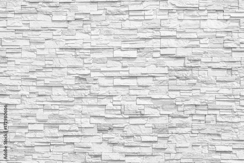 Fototapeta Surface white wall of stone wall gray tones for use as background. The new design of modern stone wall. pattern of decorative stone wall surface.