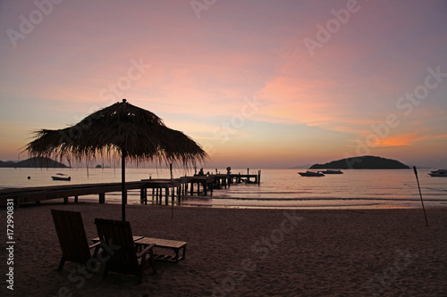 Fototapety, obrazy: relax with beautiful sunset in the evening bridge chair beach bar beach umbrella boat silhouette at Koh Mak Trad Thailand