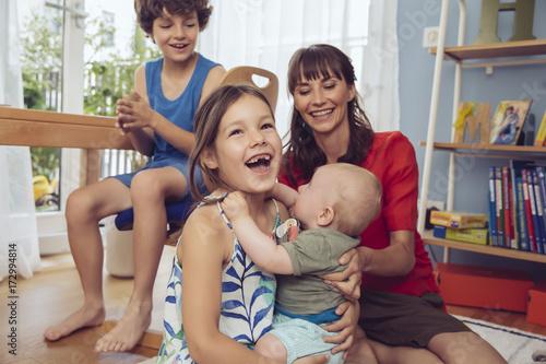 Happy family in children's room