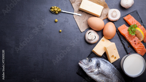 Fototapeta Black table with ingredients of food rich in vitamin D and omega 3, with copy space. obraz