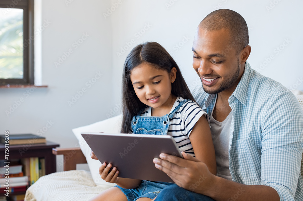 Fototapeta Father and daughter using tablet