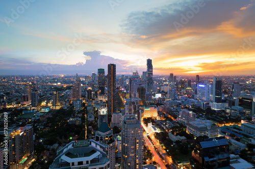 Foto op Aluminium Kuala Lumpur Modern building in Bangkok business district at Bangkok city with skyline at twilight, Thailand.