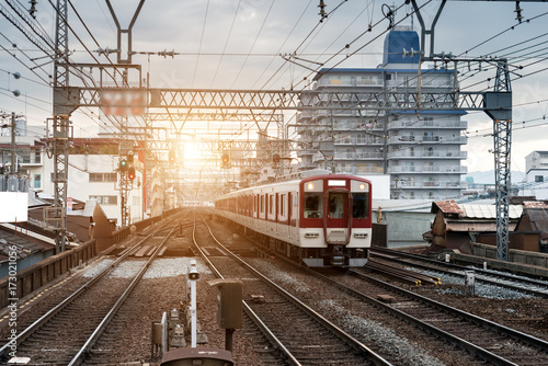 Japan train on railway with skyline at Osaka, Japan for transportation backgroun Fotobehang