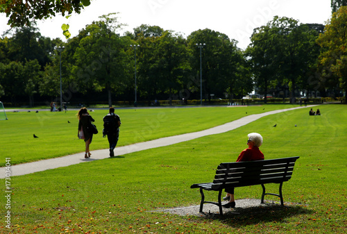An Elderly Woman Sits On A Bench In A Park Ahead Of A National Vote