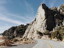 Big Rocky Peak On Rural Highway