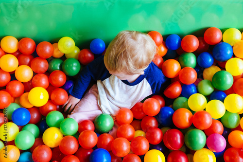 Arial view of toddler girl in colerful, fun ball pit