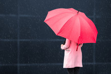 Girl With Red Umbrella On Rain...