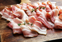 Raw Sliced Bacon With Thyme Le...