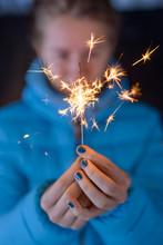 Woman Holding A Firework Sparkler
