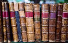 Vintage Books On A Library Shelf
