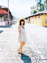 Woman Walking On Cobblestone S...
