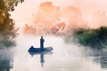 Fisherman Boat In The Morning Fog. Beautiful Dawn Scenery On Seversky Donets River, Ukraine. Fishing Background. Autumn Season Scenery.