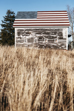 Barn With American Flag In Field