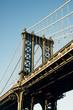 Low angle view of Manhattan Bridge against blue sky