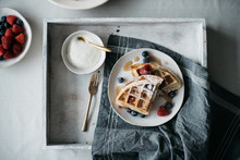 Waffles With Berries On Marble Countertop For Breakfast