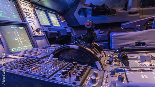 Fotografie, Obraz  Detailed view of the upper set of switches in a large airliner