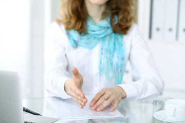 Business woman with hand out for handshake. Close-up of an open hand