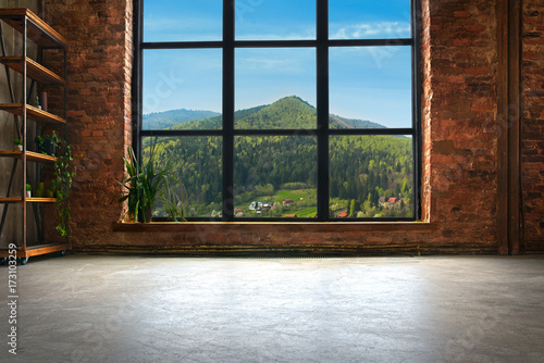 Obraz Large Loft Interior With Mountains In The Window - fototapety do salonu