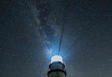 Lighthouse Beams At Night With...