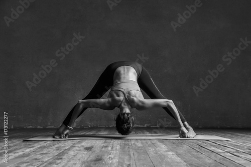 Canvas Prints Yoga school Young beautiful yoga female posing in studio