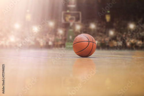 basketball ball in front of big modern basketball arena Fototapet