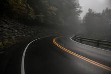 Mountain Wet Asphalt Road Curve At Fog Rainy Day