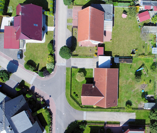 Photo Aerial photo with the drone, anew build-up plot with single houses and gardens,