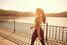 A Sporty Girl Is Walking In A ...