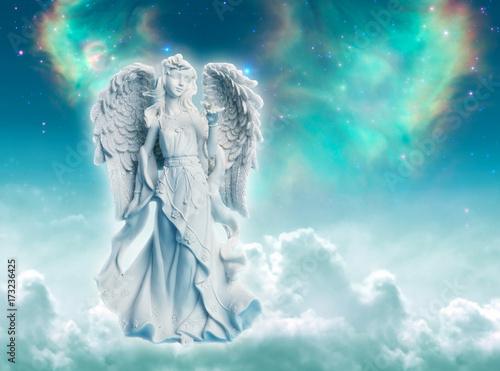 Fotografie, Obraz  Angel archangel Ariel or Gabriel or Haniel over divine mystic green starry backg