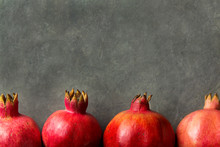 Ripe Red Vibrant Organic Pomegranates Arranged In Border On Black Stone Background Poster Greeting Card Template Banner Autumn Fall Thanksgiving Copy Space