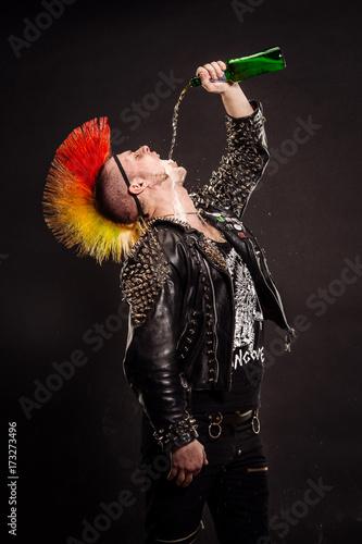 Portrait of punk rocker with Mohawk on a black background. Canvas Print