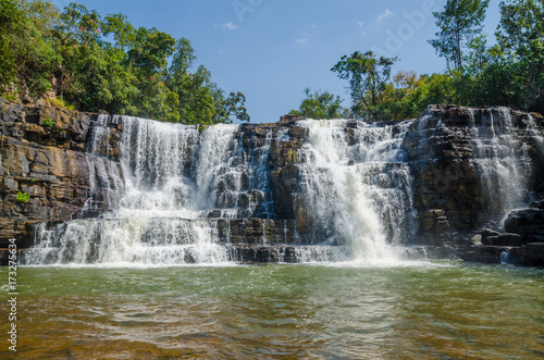 Fotomural  Beautiful Sala water falls near Labe with trees, green pool and a lot of water f