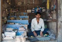 Indian Street Vendor In His Shop