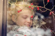Friendship Between Girl And Cat Behind Window