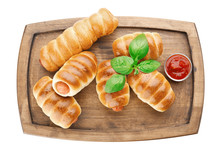 Wooden Board With Baked Sausage Rolls On White Background