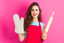 Young Woman With Cooking Theme On A Solid Background