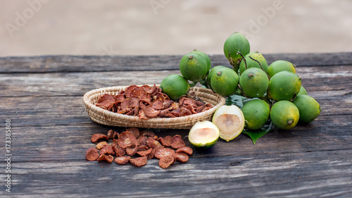 fresh betel nut with betel leaf isolated on the wood background Canvas Print