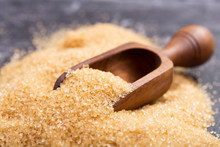 Brown Cane Sugar In A Wooden S...