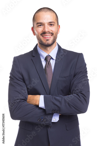 Fotografie, Obraz  Handsome smiling business man with arms crossed, isolated on a white background