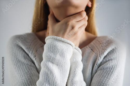 Cuadros en Lienzo Sore throat. Woman touching the neck