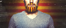 Unrecognizable Young Man With A Beard, Unraveled In Colors Of The Flag Of Catalonia. Referendum For The Separation Of Catalonia From Spain. Democracy Independence Concept