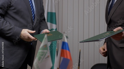 Fototapety, obrazy: Two businessman with made a deal. Two businessmen shaking hands indicating successfully made deal