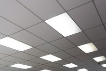 White Ceiling With Neon Light Bulbs In Uprisen View. Copy Space.