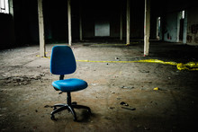 Office Chair Sits In The Middl...